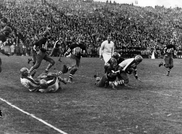 American Football - Columbia University versus Cornell - New York, USA. Columbia's star player Ralph Hewitt (1907-1987) is brought down by Pond of Cornell in the third period of the battle between the old rivals at Baker Field, which Columbia won 10-7