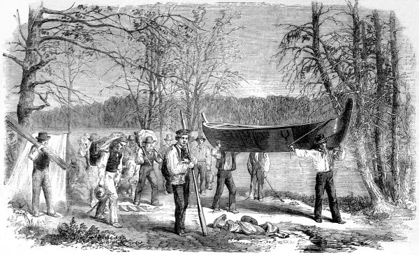 In the expedition party were 14 Iroquois Indians, 2 French Canadians and various geologists, civil engineers, suveyors and draughtsmen. Here the party is seen carrying a canoe between lakes and rivers