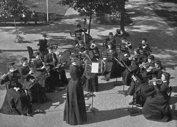 An American ladies' military band, playing in a park. Date: 1900