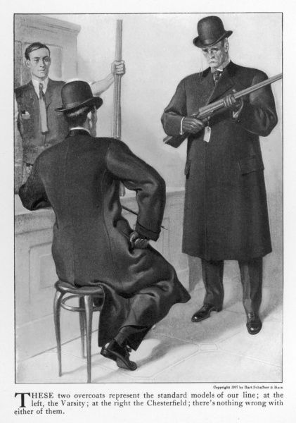 American father wearing a Chesterfield overcoat with velvet collar & fry-front & son in a Varsity overcoat shop for guns. Both wear bowler (Derby) hats