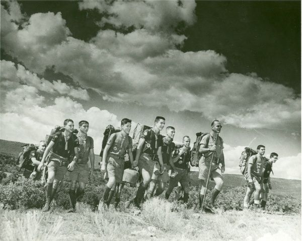 A group of American Boy Scouts walking through open countryside. circa 1960s