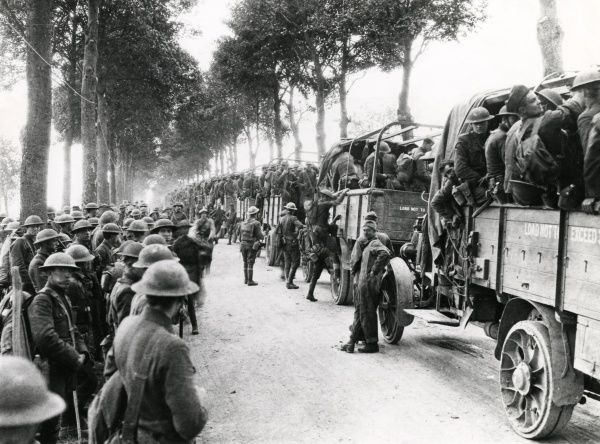 American troop transport on a road west of Moulins, northern France, during the First World War. The men of the 7th Infantry are being transported away from the western front for a well-earned rest. Date: 30 July 1918