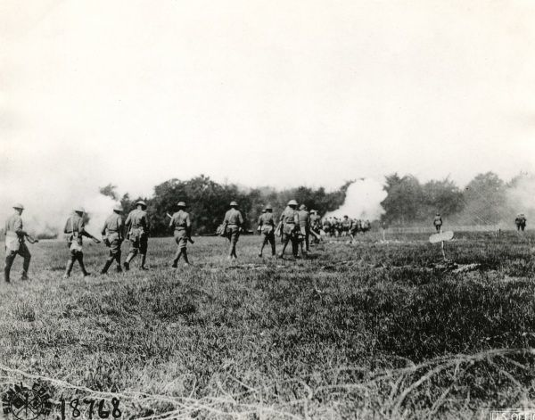 American troops of the 326th Regiment in action at Choloy, north eastern France, during the First World War. They are attacking German trenches.  August 1918