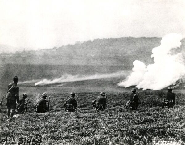 American troops in action, firing phosphorous bombs near Le Nefour, France, during the First World War. Date: 26 October 1918