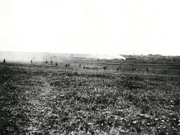 American troops of the 37th Division in action at St Barbe, France, during the First World War. They are taking enemy trenches -- signal flares can be seen in the distance. Date: August 1918