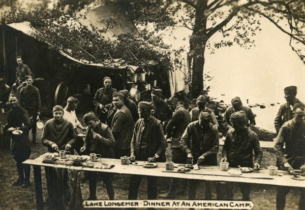 American troops enjoying an open air dinner at a camp, Lake Longemer, north eastern France, during the First World War. Date: 1918