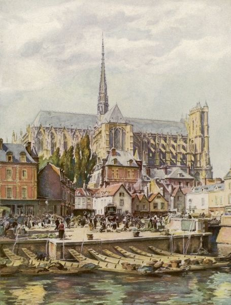 The cathedral seen from across the river Somme Date: circa 1910