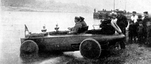 Photograph of a Canot-Automobile Ravailler amphibious car taking to the water, France, 1909