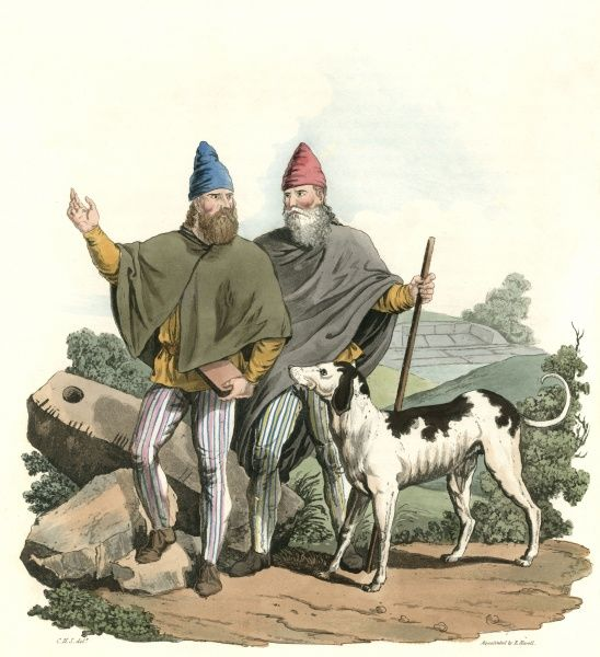 A BREHON, a judge of ancient Ireland, with his FILIDH, whose job it was to know all the laws and be able to quote them. With them is an Irish wolfhound. Date: early centuries AD