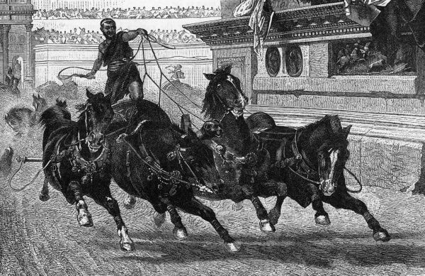 An Ancient Roman charioteer drives his four horses hard around the track. The prime venue for this type of sport was the Circus Maximus in Rome. Date: BCE
