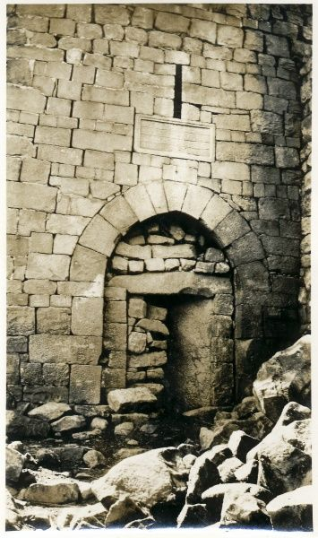 An ancient stone gateway which has been bricked up, somewhere in the Middle East