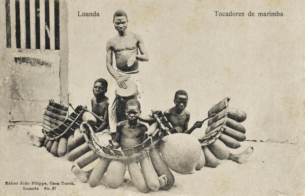 Luanda, Angola, Africa - A local band with seated Marimba players