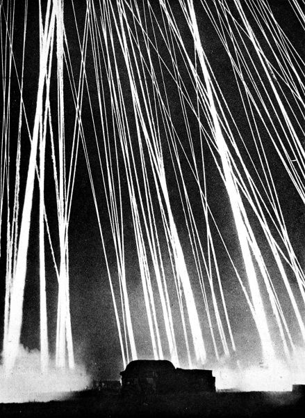 Photograph showing the firing of anti-aircraft rockets at night, by British Home Guard units, during 1944