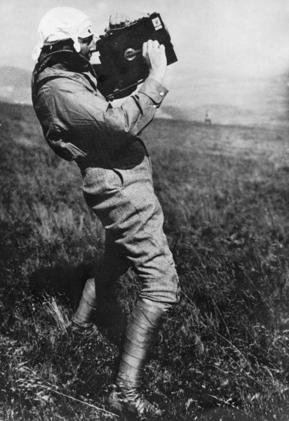 Anton Herman Gerard (Anthony) Fokker (1890-1939), Dutch aviation pioneer and aircraft manufacturer, famous for the fighter aircraft he produced in Germany during the First World War. Seen here filming one of his own aircraft in flight. Date