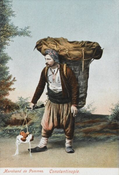 A sturdy apple seller from Constantinople, carrying a gigantic lined woven wicker pannier and a set of delicate scales