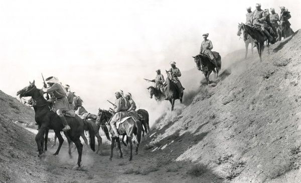 Arab mounted police crossing the bed of an ancient canal in Mesopotamia during the First World War. Date: 1918