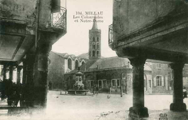 The Place du Marechal Foch, 12th century arcades and the Church of Notre-Dame-de-l'Espinasse at Millau, France