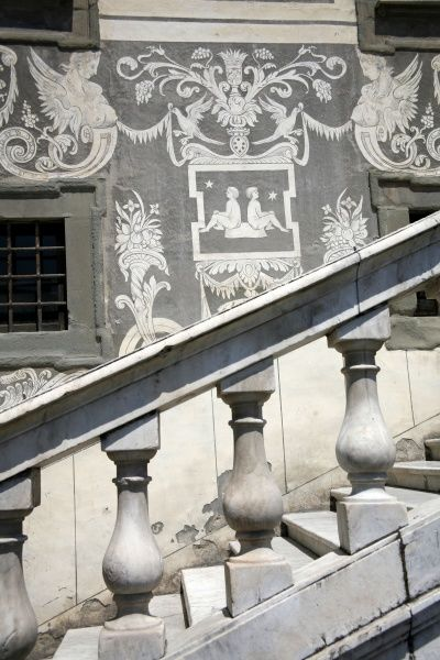 Architectural detail and stairs on the Palazzo della Carovana in Pisa, Italy