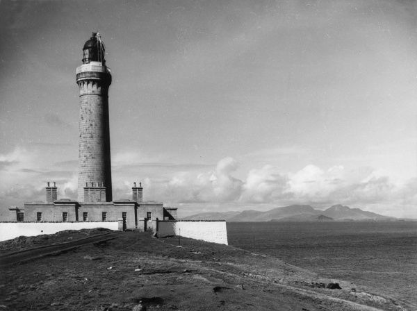 The lighthouse at Ardnarmurchan, Argyllshire, Scotland, with the Isle of Rum in the distance. Date: 1950s