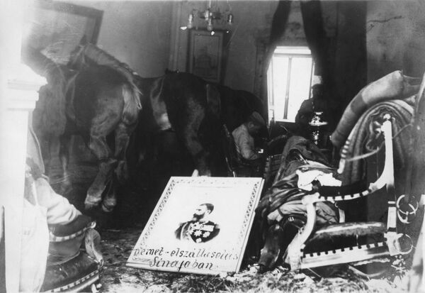 Homeless Armenian refugees occupy a fine house, with their horses stabled in the living room and a portrait lying symbolically across the floor