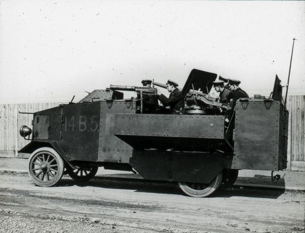 An armoured truck design undergoing testing by soldiers during the First World War