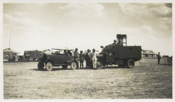 An armoured truck and a support vehicle with soldiers, somewhere in the Middle East