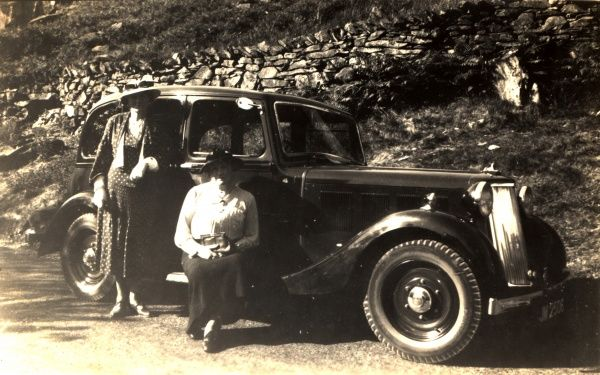 Two ladies (one seated on the running board) next to a 1.7 Litre Armstrong Siddeley