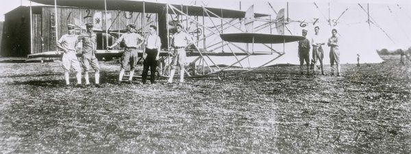 The US Army's first plane, seen here with crew at Fort Myer, Virginia, USA, after it had been equipped with wheels. It was the first successful aeroplane in the world, powered by a Wright B45 engine. Date: 1909