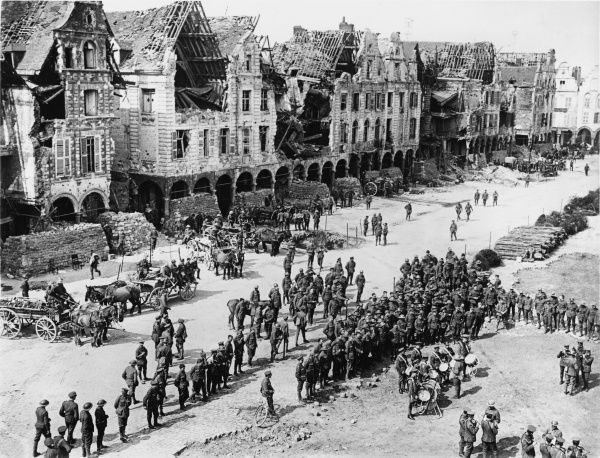 British Military Band playing in the ruins of the Grand Place in Arras in France on the British front during World War I on 29th April 1917