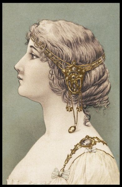 An Art Nouveau headdress of ornamental fillet with elongated sections, incorporating a cameo, hanging over the ears. Also matching ornamental shoulder straps