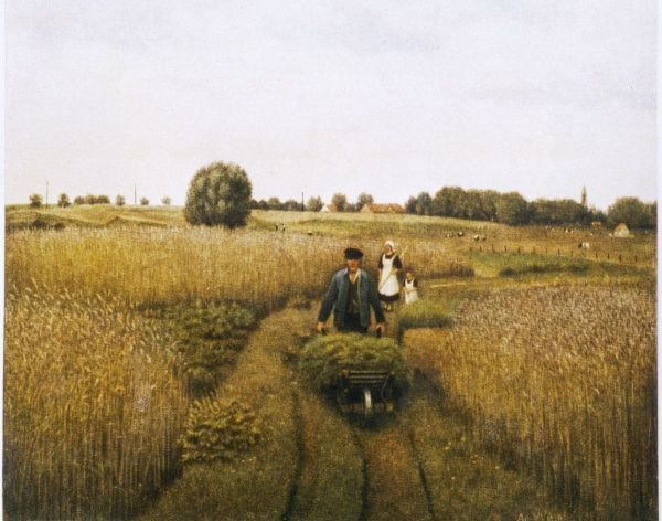 A farmer pushes his wheelbarrow, followed by his wife and little girl