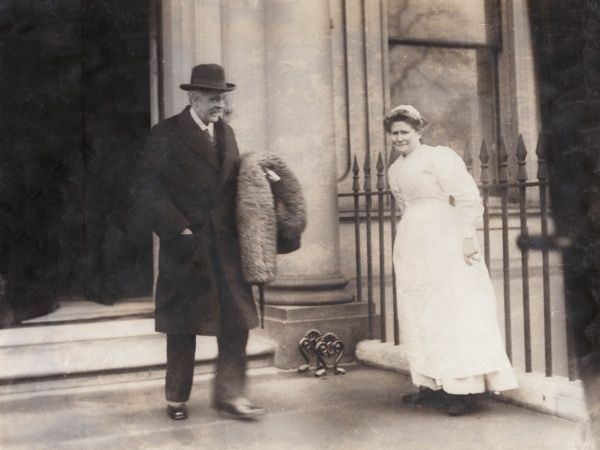 Arthur James Balfour, Conservative MP and former Prime Minister, leaving his London house for Biarritz, possibly for a health cure. His housekeeper stands deferentially to one side as he takes his leave