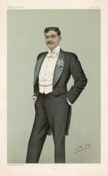 Black tailcoat & trousers, white waistcoat with roll collar & cut low revealing an expanse of shirt front, stand collar & white tie, gold watch chain & orchid buttonhole