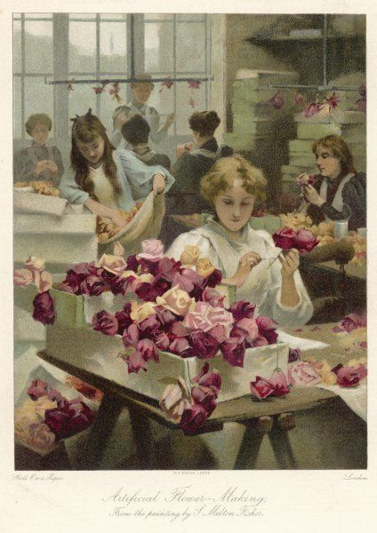 Girls and young women in a well lit workroom carry out various tasks in the process of artificial flower making. They appear to be making roses