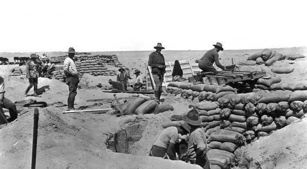 The 2nd Divisional Artillery strengthening the Suez Canal defences. The men are seen here making two gun emplacements behind the desert lines
