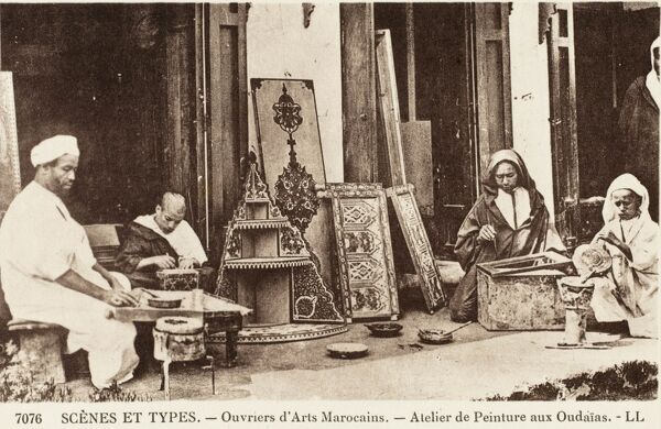 Moroccan street artisans, making decorative inlaid furniture items in wood and metal