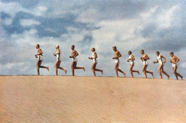 "The Aryan race : ""nobility of blood, incomparable beauty of form and mind, and a superior breed"". Men and women running along the beach demonstrate strength and beauty"