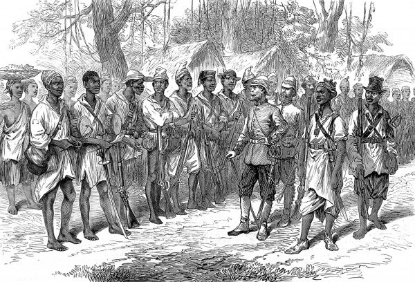 British officers inspecting Kossohs, or warriors from a tribe hostile to the Ashanti, at the British camp based at Prahsu. The second Ashanti War fought between,1873-74, was between King Kofi Karikari, ruler of the Ashanti (or Asantehene), and the British