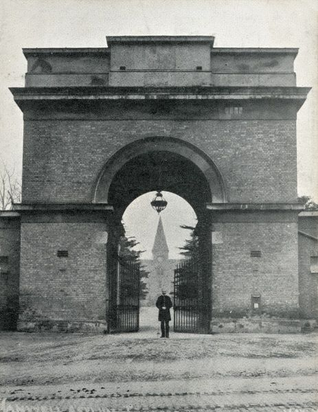 Entrance to the county lunatic asylum at Hanwell in Middlesex opened in 1831. A porter stands at the gates beneath the portico. The site later became St Bernard's Hospital. Date: Date unknown