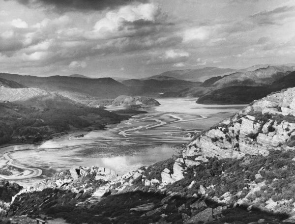 'Sunshine and Storm Clouds': An impressive atmospheric scene over the Mawddach Estuary, near Barmouth, Merionethshire, North Wales