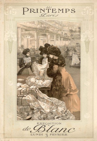 Ladies consider purchasing a tablecloth from the elegant and spacious store on the Boulevard Haussmann