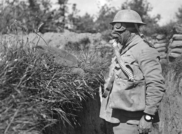 An Australian chaplain wearing a box respirator to protect him from a gas attack at Fleurbaix, northern France, during the First World War. Date: June 1916