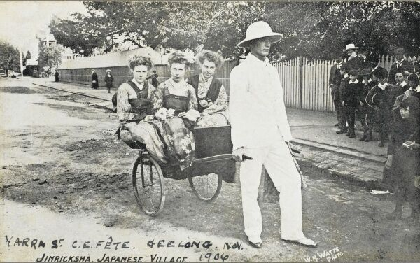 An Australian Church Fete at Yarra, Geelong - 41 miles from Melbourne. The three women being transported by rickshaw are all wearing Japanese kimonos. It is captioned 'Jinricksha, Japanese Village&#39