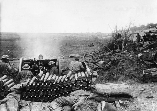 An Australian 18-pound field gun firing at Bullecourt, northern France, on the Western Front during the First World War. A large stack of shells can be seen in the foreground, ready for use. Date: 19 May 1918