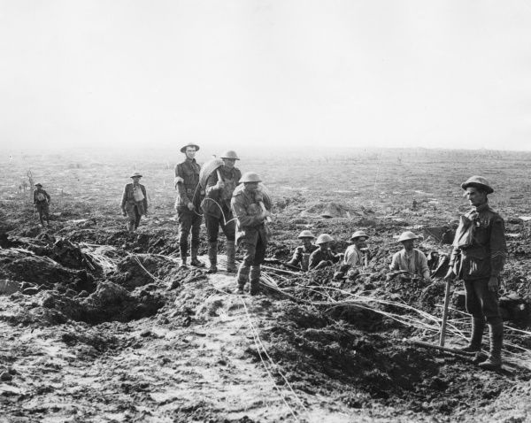 Australian Signals laying cable in a muddy area near Albert, northern France, during the First World War. Date: 21 September 1917