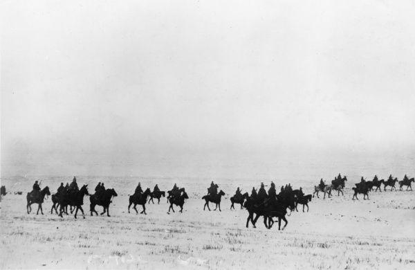 Austrian cavalry riding through a snowy landscape during the First World War. Date: 1914