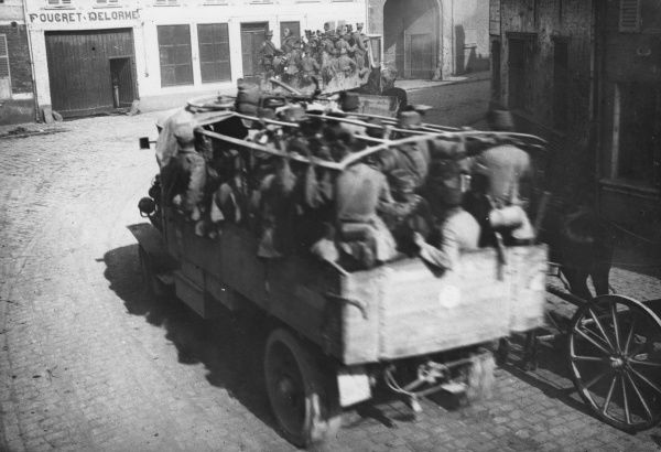 Austrian infantry travelling in trucks through a French town on the Western Front during the First World War. Date: 1914-1918