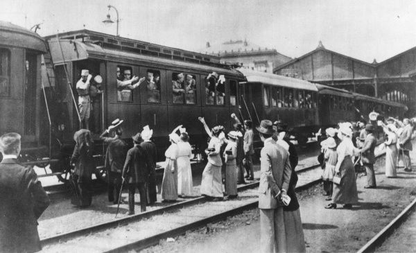 Austrian troops leaving by train for the front during the First World War, with friends and family waving goodbye. Date: 1914-1918