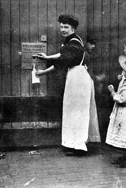 Photograph from 1909 showing a penny-in-the-slot milk-machine