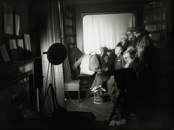Automatic photograph of sitters and Rudi Schneider at a sance at the National Laboratory of Psychical Research, 8 March 1932